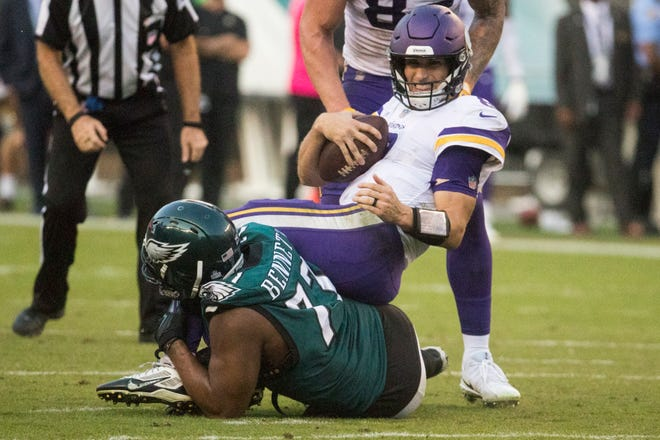 Eagles' Michael Bennett takes down Minnesota quarterback Kirk Cousins Sunday at Lincoln Financial Field.