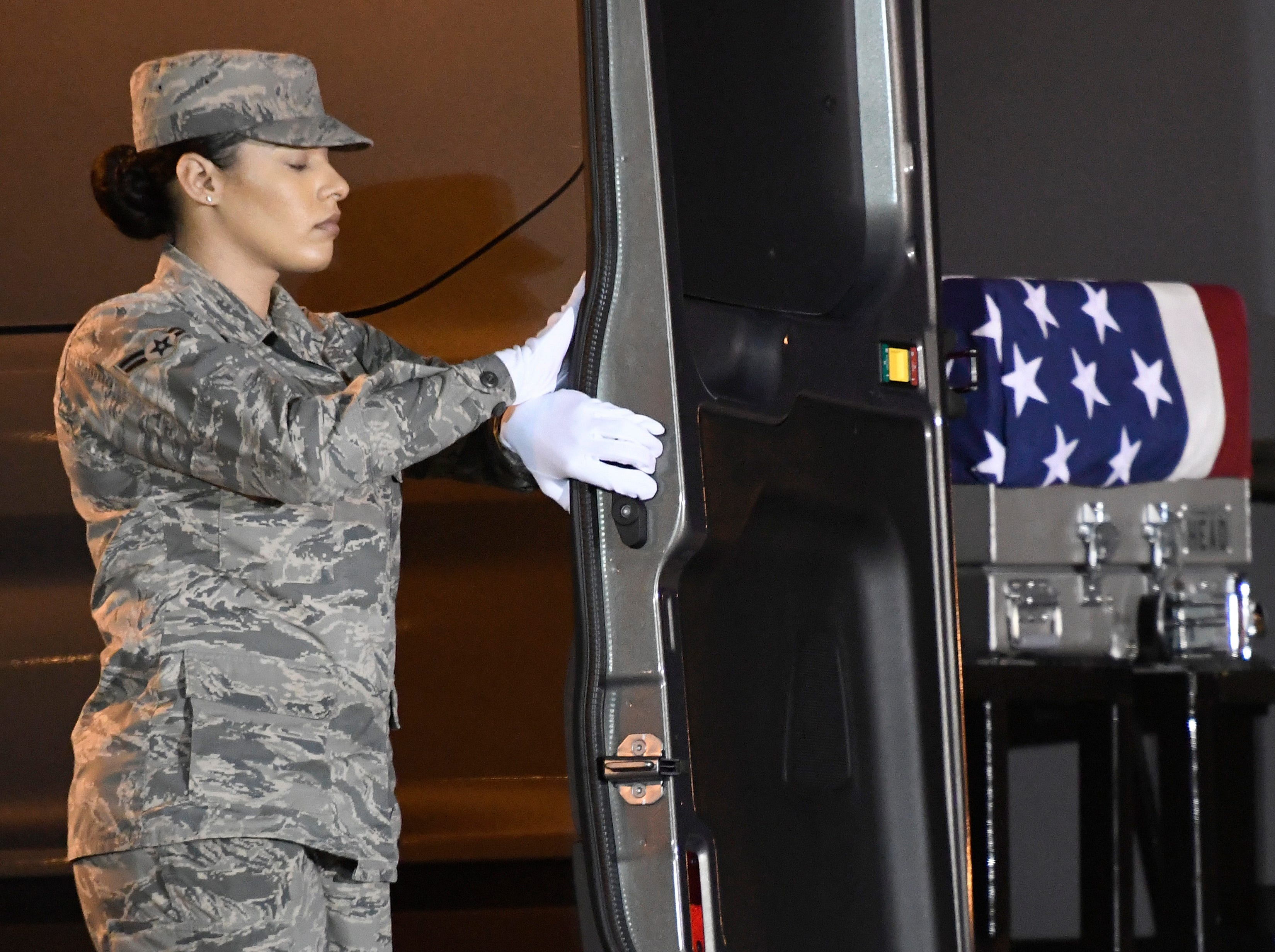 Airman 1st Class Italia Sampson closes a vehicle holding a transfer case containing the remains of Army Sgt. James A. Slape at Dover Air Force Base, Del., on Saturday, Oct. 6, 2018. According to the Department of Defense, Slape, 23, of Morehead City, N.C., died Oct. 4, 2018 in Helmand province, Afghanistan, of injuries sustained from an improvised explosive device.