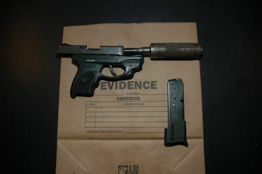 A loaded Ruger 9 MM handgun equipped with a silencer and an obliterated serial number seized by State Police.