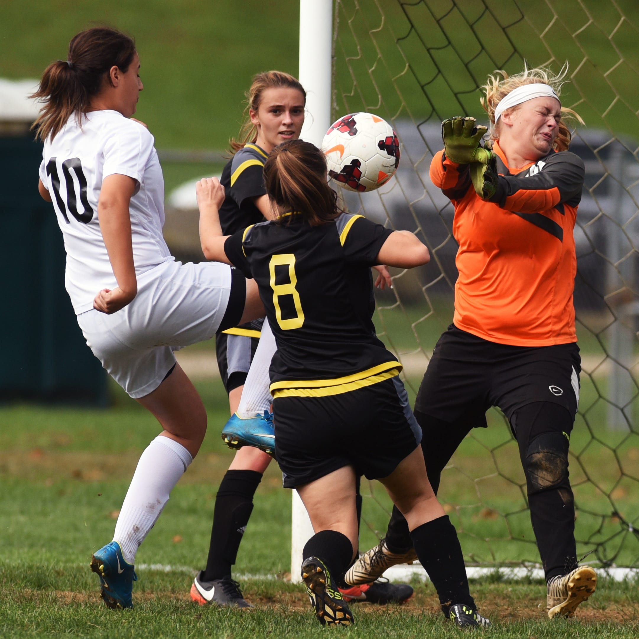 Bailey Long O'Rourke knees a shot past Tri-Valley keeper Faith Prouty during the Lady Bears' 7-0 win against Tri-Valley on Saturday at Kenny Wolford Park. The win sent River View to 11-3-1 overall.
