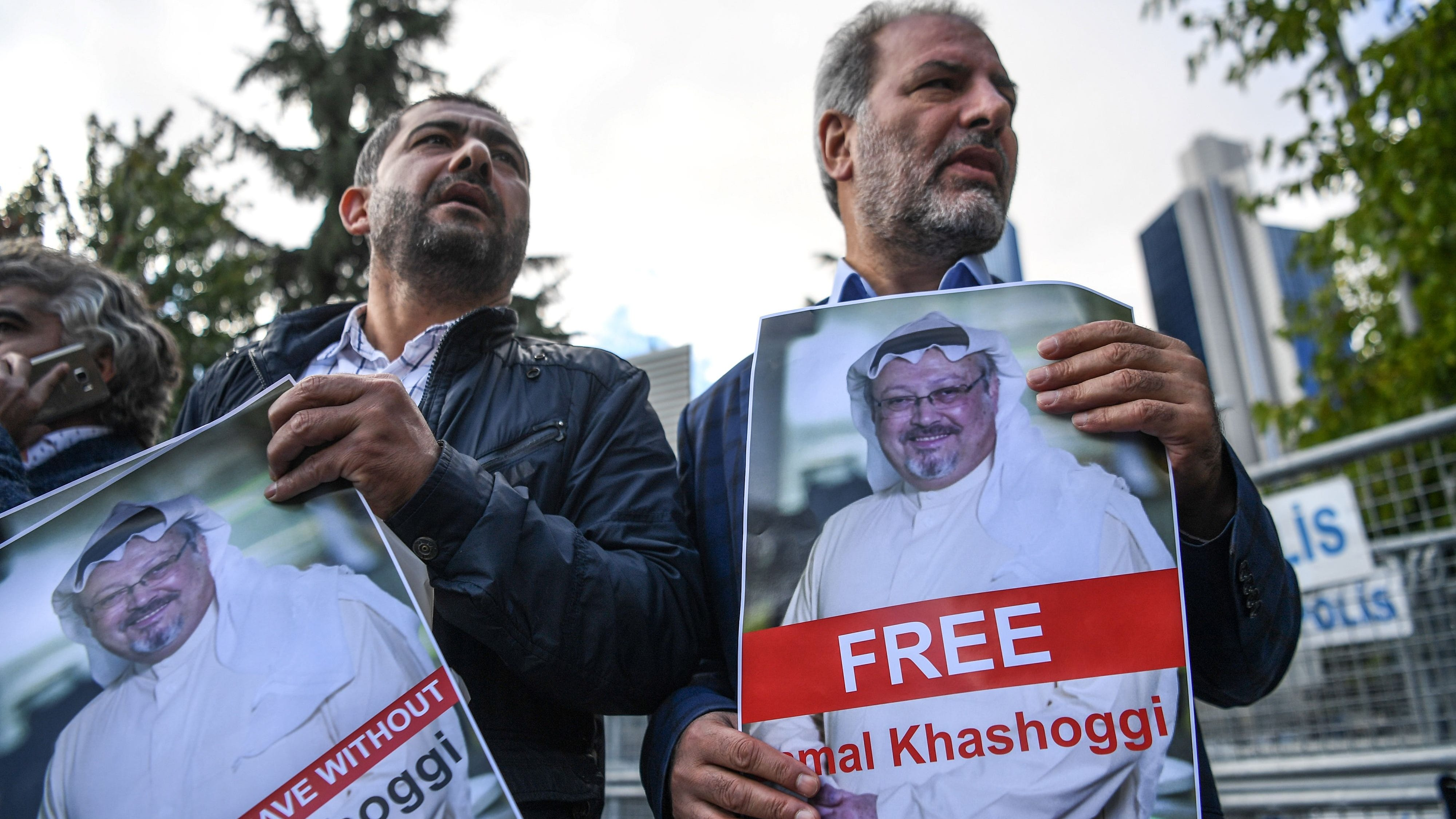 Protestors hold pictures of missing journalist Jamal Khashoggi during a demonstration in front of the Saudi Arabian consulate, on October 5, 2018 in Istanbul.