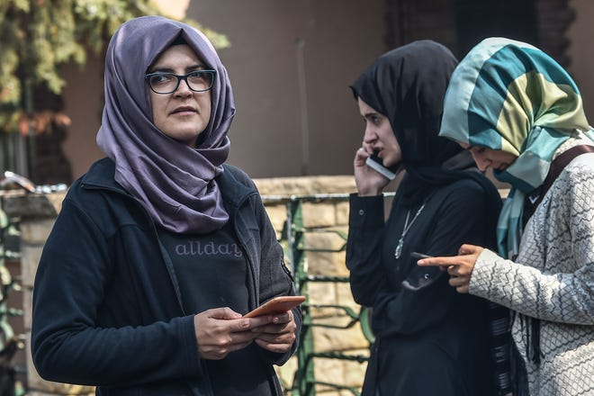 Missing journalist Jamal Khashoggi's Turkish fiancee Hatice (L) and her friends wait in front of the Saudi Arabian consulate in Istanbul, on October 3, 2018.