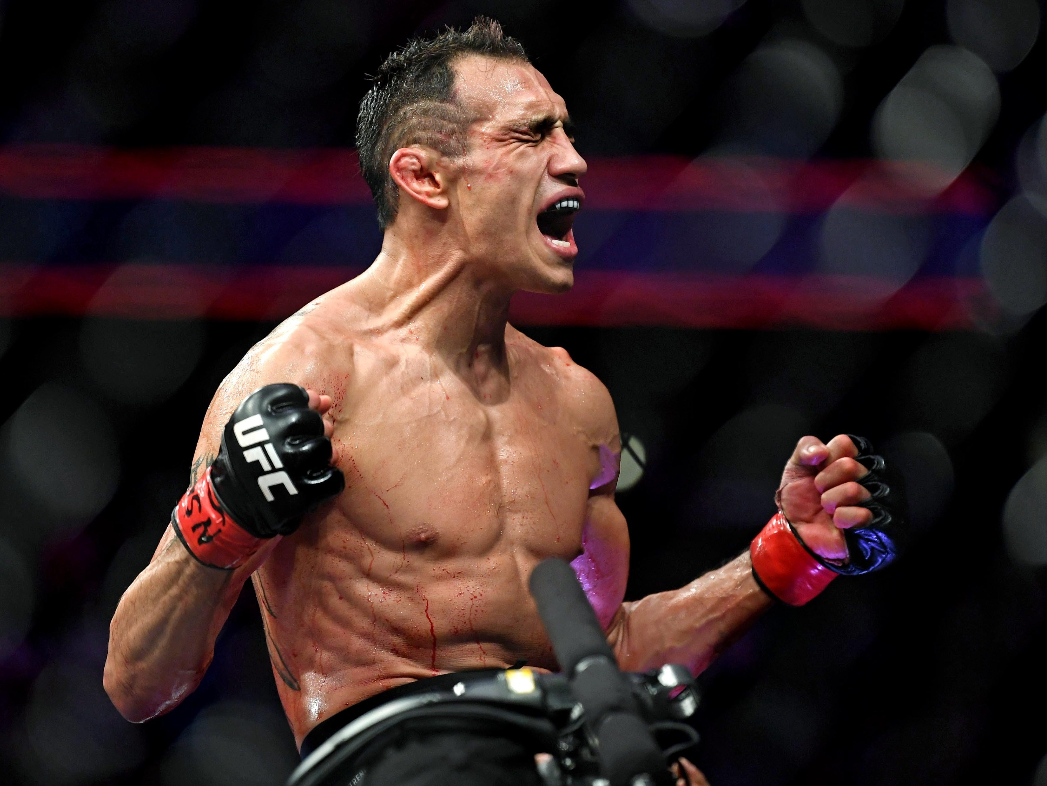Tony Ferguson celebrates after beating Anthony Pettis via an injury TKO.