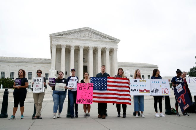 Activists demonstrate in front of the Supreme Court on Oct. 6, 2018.