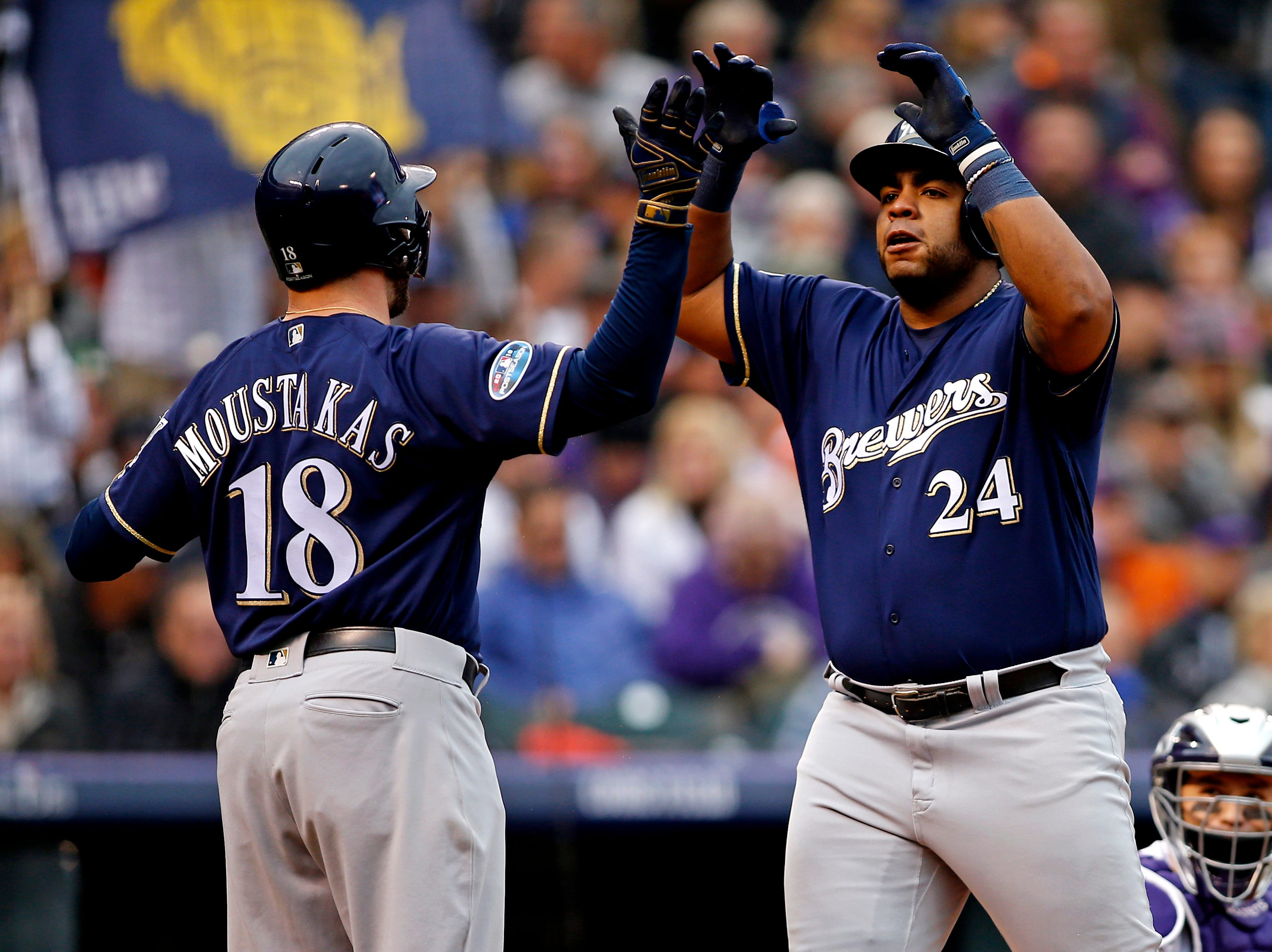 NLDS Game 3: Brewers first baseman Jesus Aguilar celebrates his home run in the fourth inning.