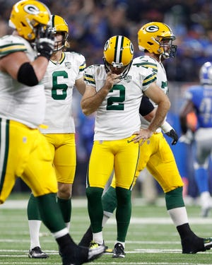 Green Bay Packers kicker Mason Crosby (2) puts his head down after missing a field goal during the second quarter against the Detroit Lions at Ford Field.