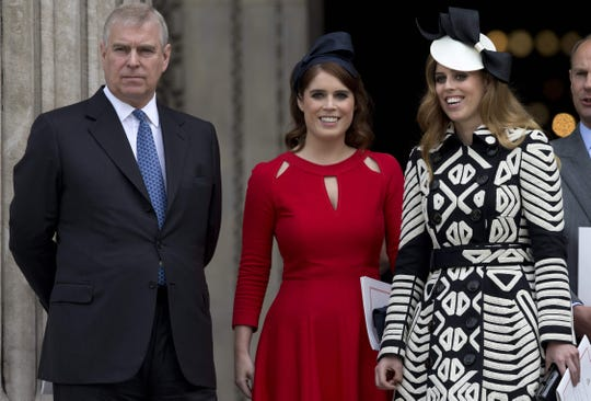 Prince Andrew, Duke of York, with his daughters, Princess Eugenie and Princess Beatrice, after attending a national service of thanksgiving for the 90th birthday of Queen Elizabeth II at St. Paul's Cathedral in London on June 10, 2016.