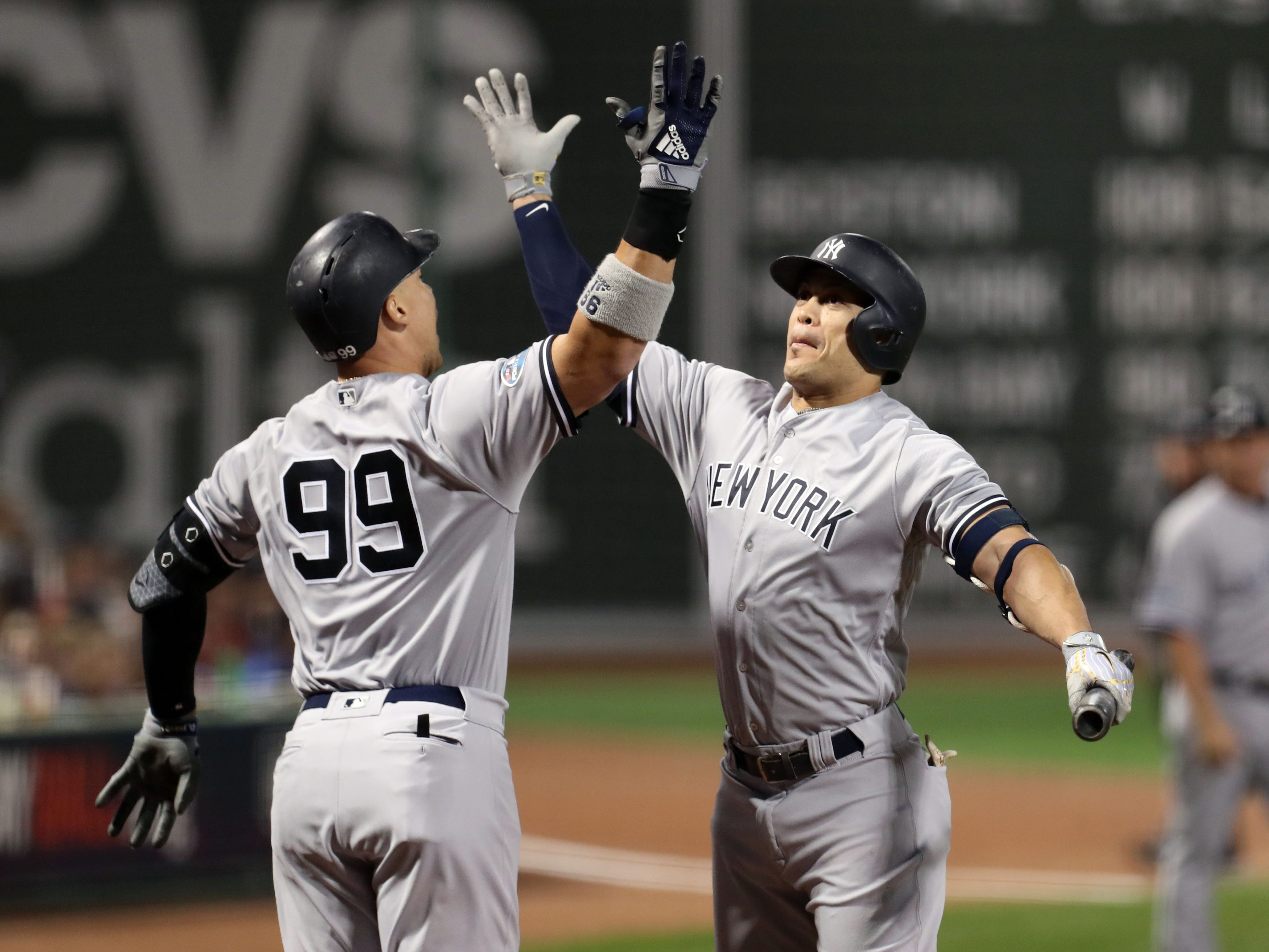 ALDS Game 2: Yankees'Aaron Judge celebrates with Giancarlo Stanton after hitting a solo home run.