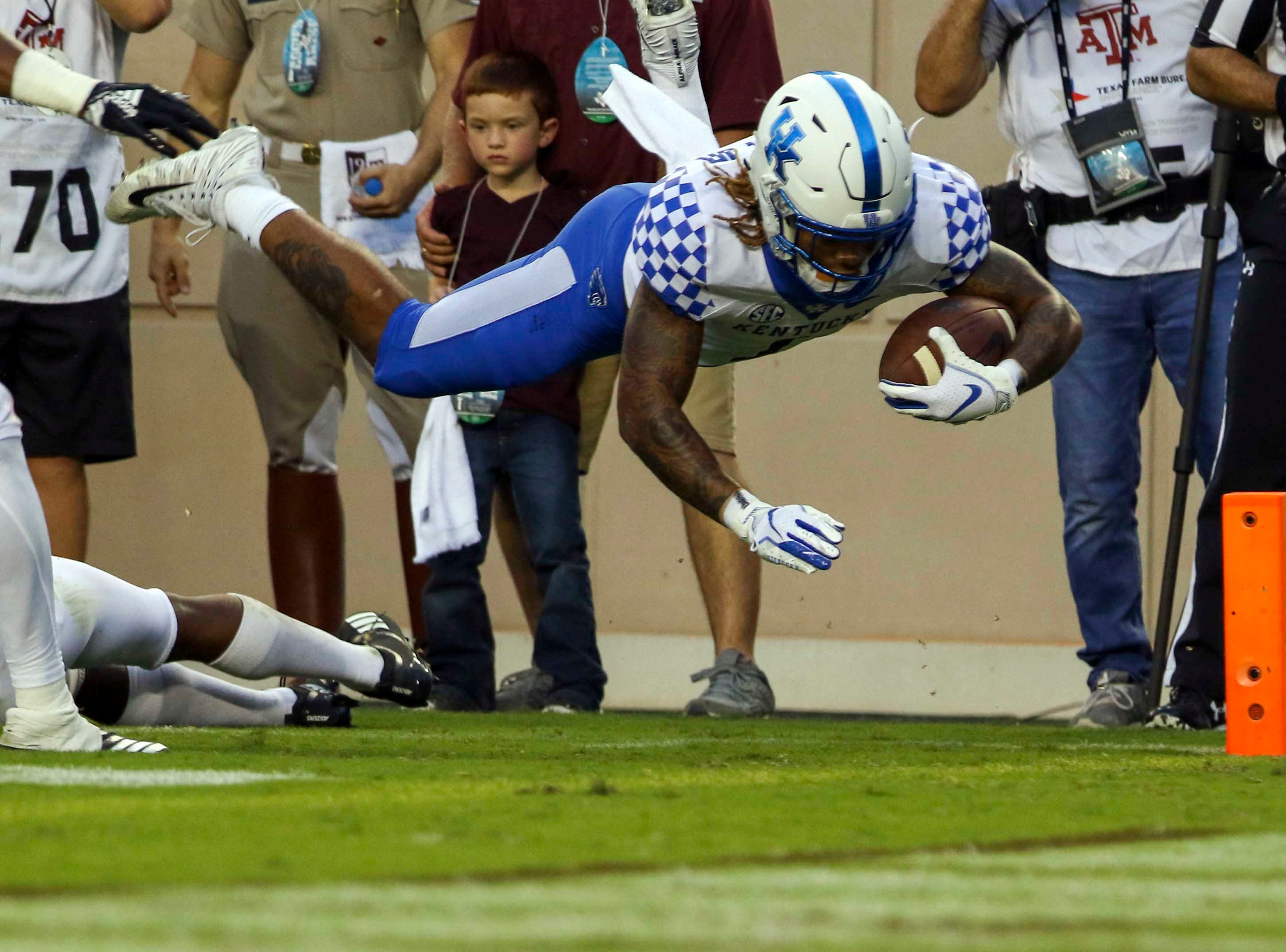 Kentucky Wildcats wide receiver Lynn Bowden Jr. (1) dives into the end zone for a touchdown during the first quarter against the Texas A&M Aggies at Kyle Field.