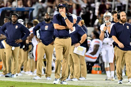 Auburn coach Gus Malzahn walks  the sidelines during the first half of the Tigers' loss to Mississippi State.