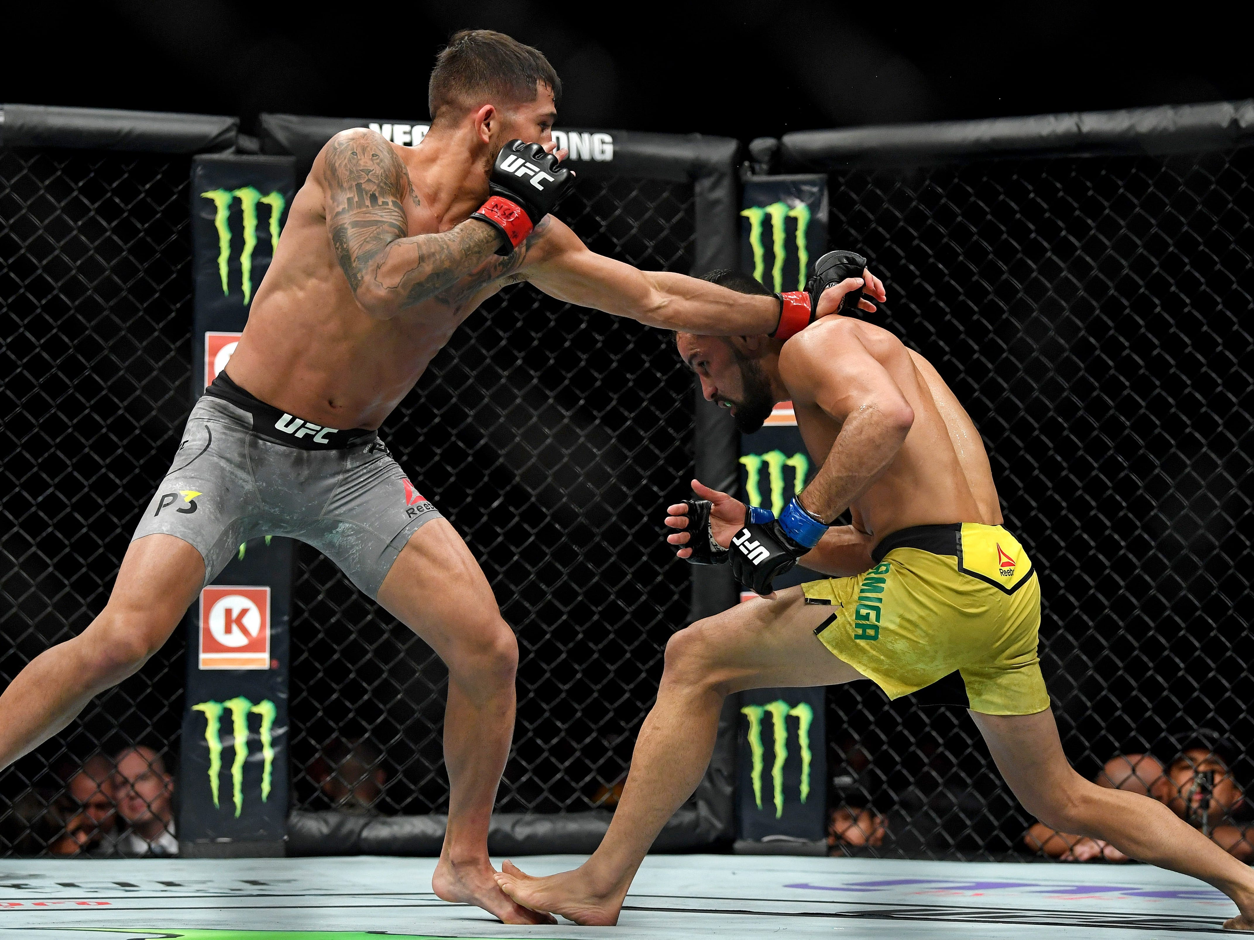 Jussier Formiga  looks to take down Sergio Pettis.