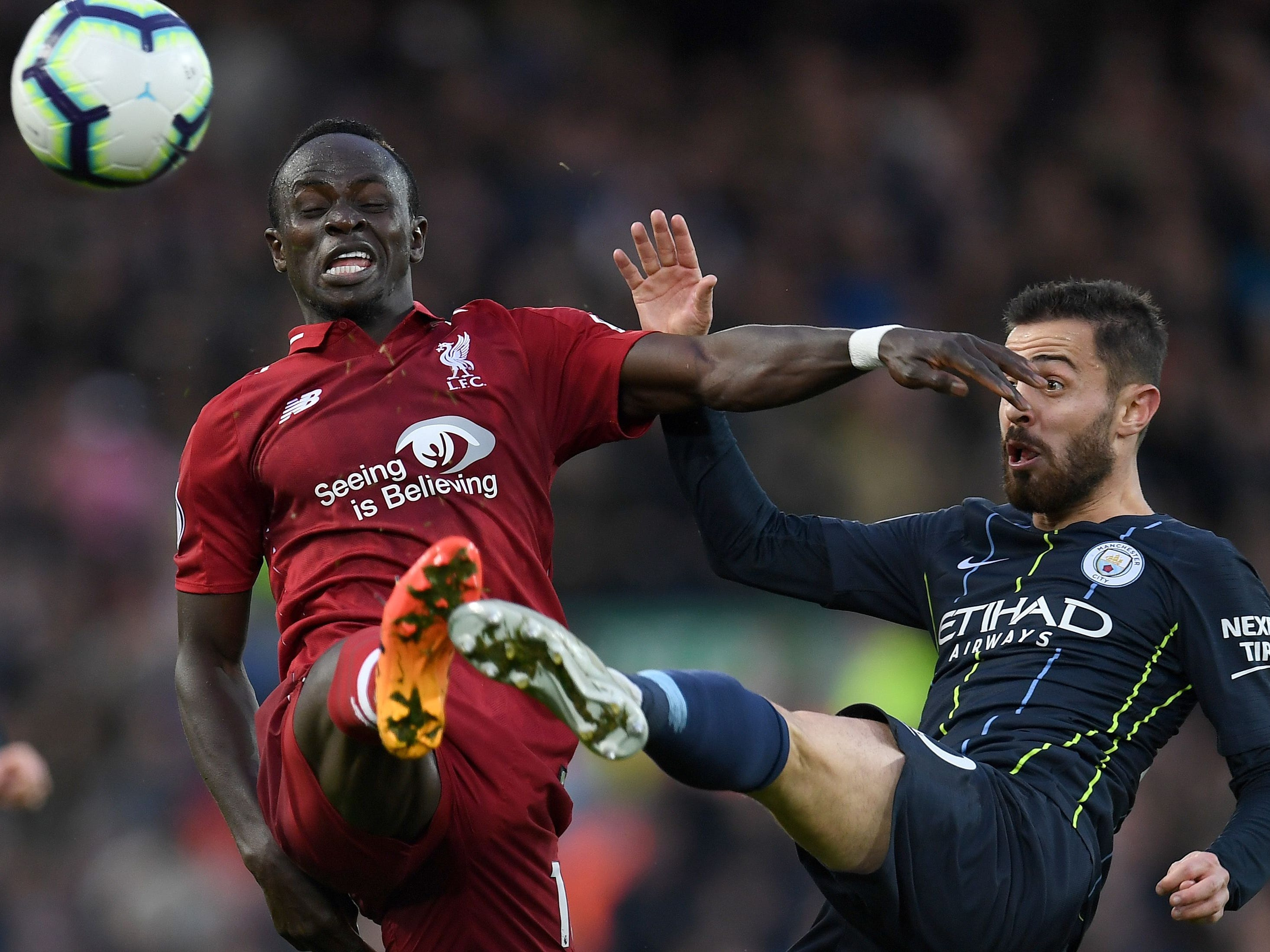 Liverpool's Sadio Mane vies with Manchester City's Bernardo Silva during the English Premier League football match between Liverpool and Manchester City at Anfield in Liverpool.