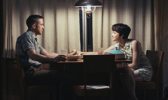 "Neil Armstrong (Ryan Gosling) gets support from wife Janet (Claire Foy) on the homefront in ""First Man."""