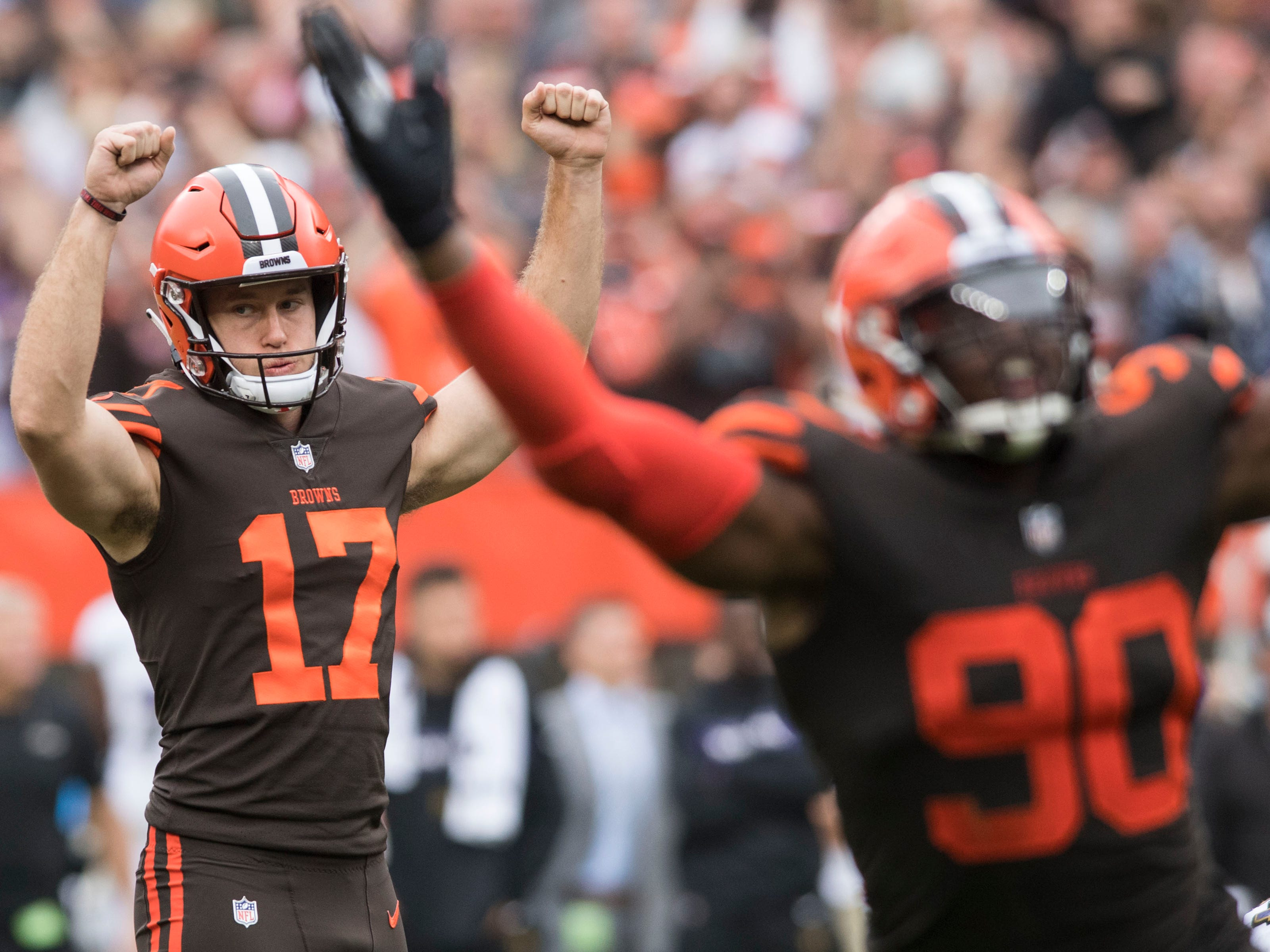 Cleveland Browns kicker Greg Joseph (17) and defensive end Emmanuel Ogbah (90) celebrate after Joseph kicked the game-winning field goal in overtime against the Baltimore Ravens at FirstEnergy Stadium.