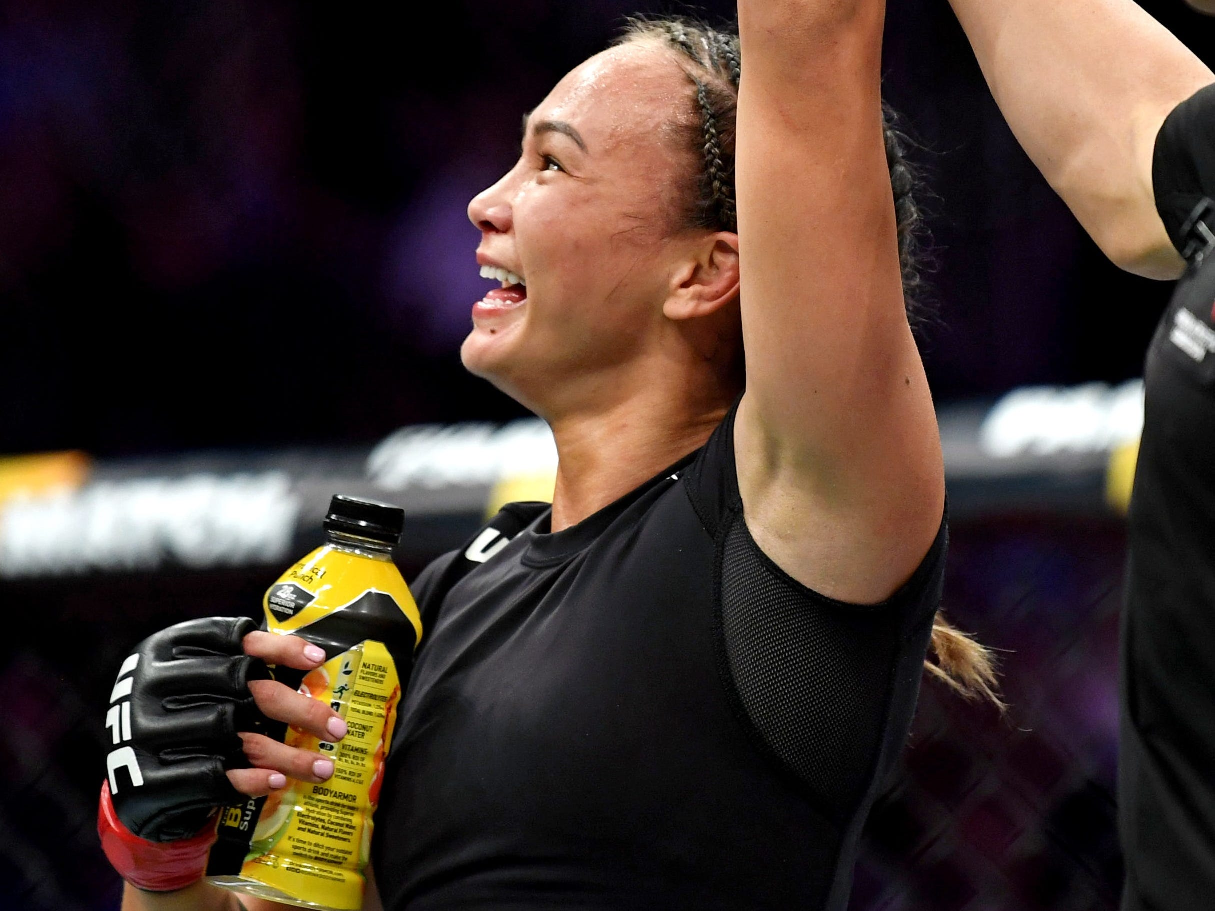 Michelle Waterson celebrates after beating Felice Herring by a unanimous decision.