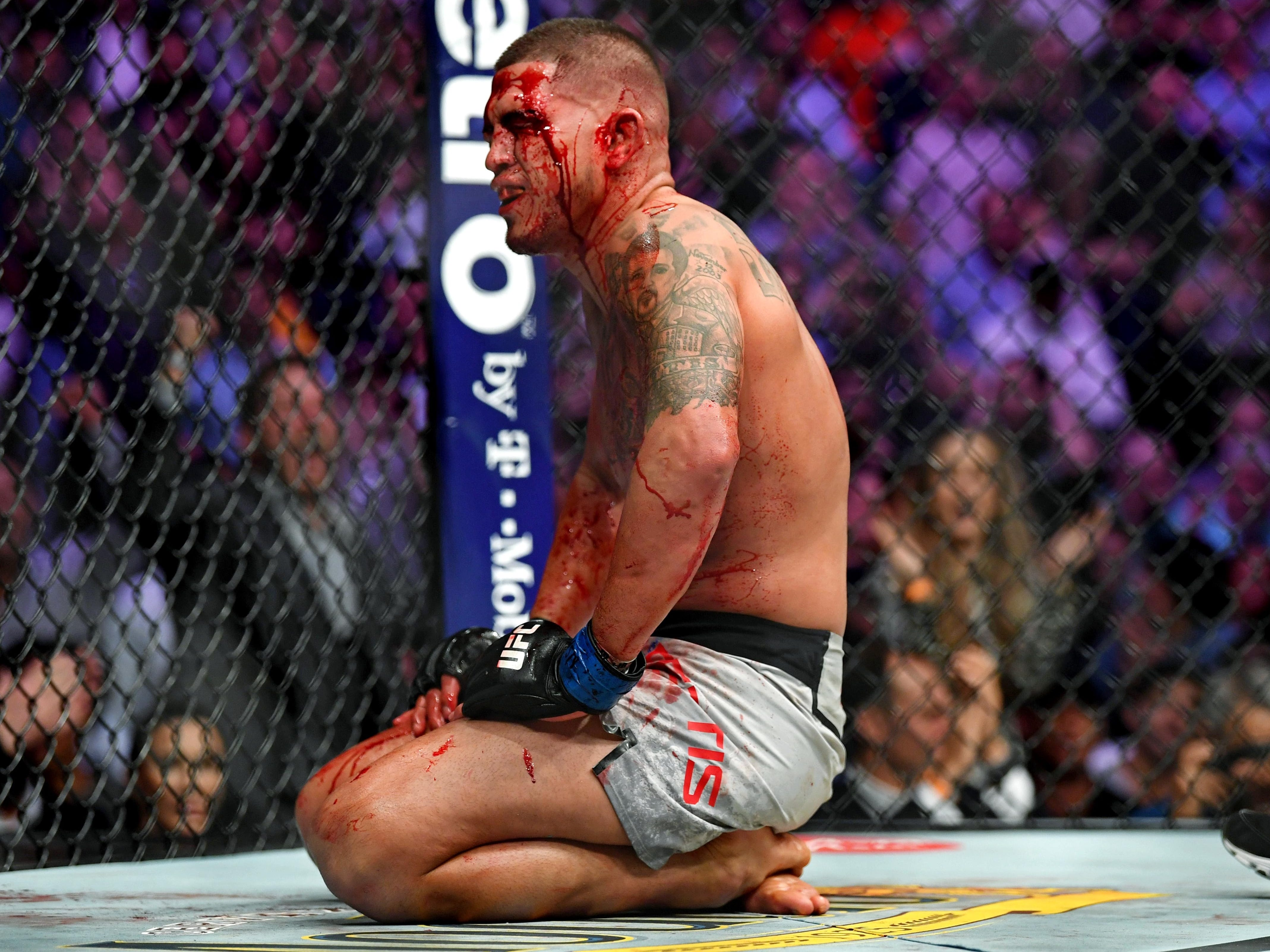 A bloody and battered Anthony Pettis on the mat after losing to Tony Ferguson. Pettis' corner stopped the fight after two rounds when Pettis suffered a broken hand.