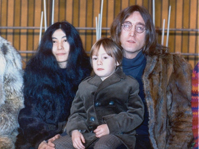 "FILE- In this1968 file photo member of British pop band The Beatles John Lennon poses with his son Julian, sitting on his lap, and  Yoko Ono at an unknown location in 1968. The woman who as a child was the basis for the Beatles song ""Lucy in the Sky with Diamonds"" is gravely ill.  It was thought by many at the time that the psychedelic song from Sgt. Pepper's Lonely Heart Club Band was a paean to LSD because of the initials in the title, but it was actually based on a drawing that John Lennon's young son Julian brought home from school. He told his father the drawing was of Lucy in the sky with diamonds.  Lucy Vodden, now living in Surrey just outside of London _ drifted apart after schoolyard days, but they have gotten back in touch as Lennon has tried to help Vodden cope with Lupus, a life-threatening disease. (AP Photo)**  HOLD FOR STORY  ** ORG XMIT: LGK102"