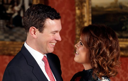 Princess Eugenie and Jack Brooksbank in the Picture Gallery at Buckingham Palace after they announced their engagement in London on Jan. 22, 2018.