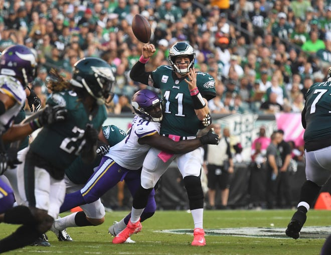 Minnesota Vikings defensive end Everson Griffen (97) forces a fumble by Philadelphia Eagles quarterback Carson Wentz (11) in the second quarter at Lincoln Financial Field.