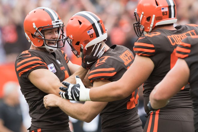 Browns punter Britton Colquitt celebrates with kicker Greg Joseph after Joseph kicked the game winning field in overtime against the Ravens.