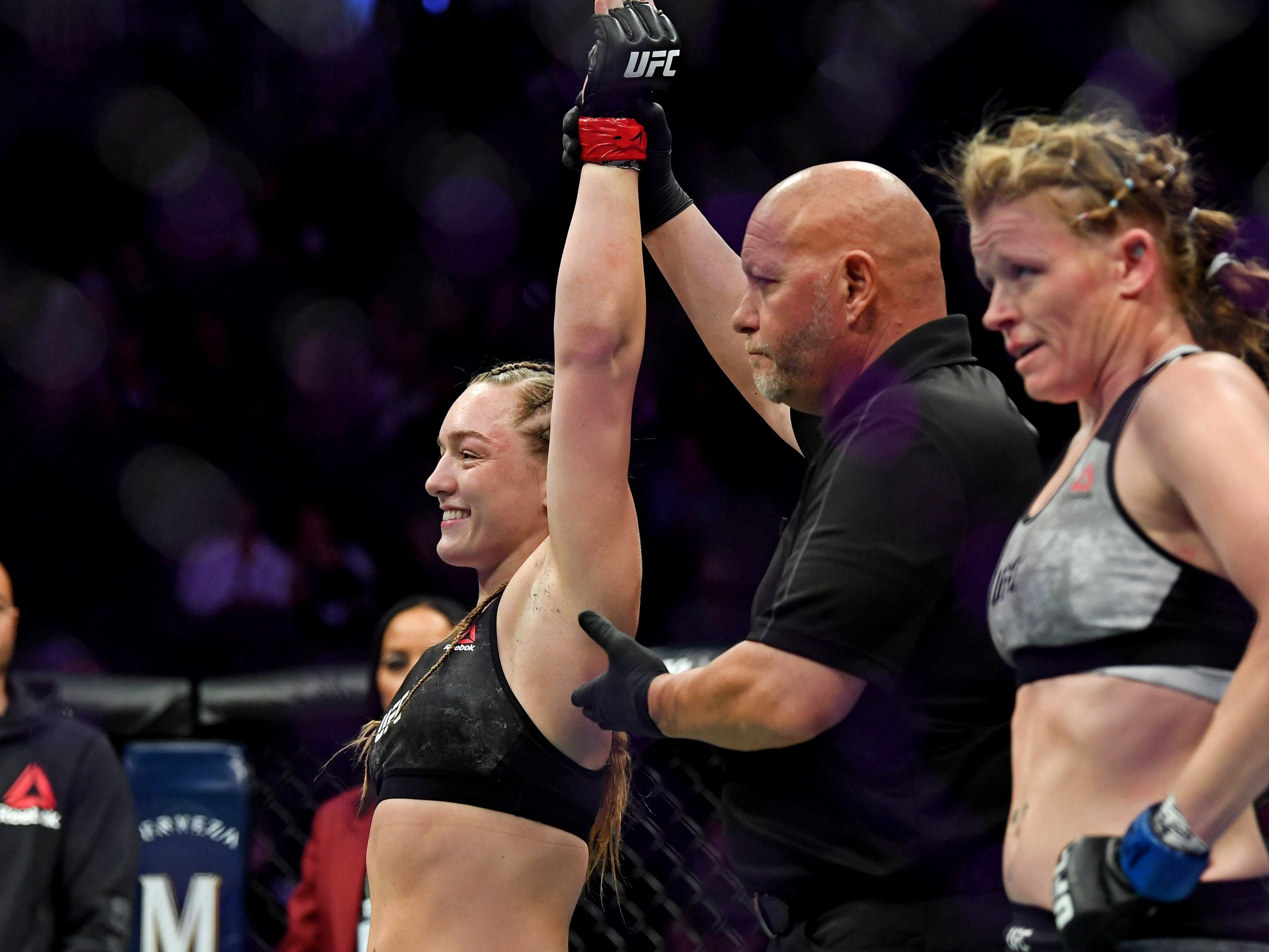 Aspen Ladd celebrates after beating Tonya Evinger with a first-round TKO.