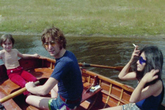 John and Yoko with John's son Julian, rowing on the lake at Tittenhurst Park on July 17, 1971.