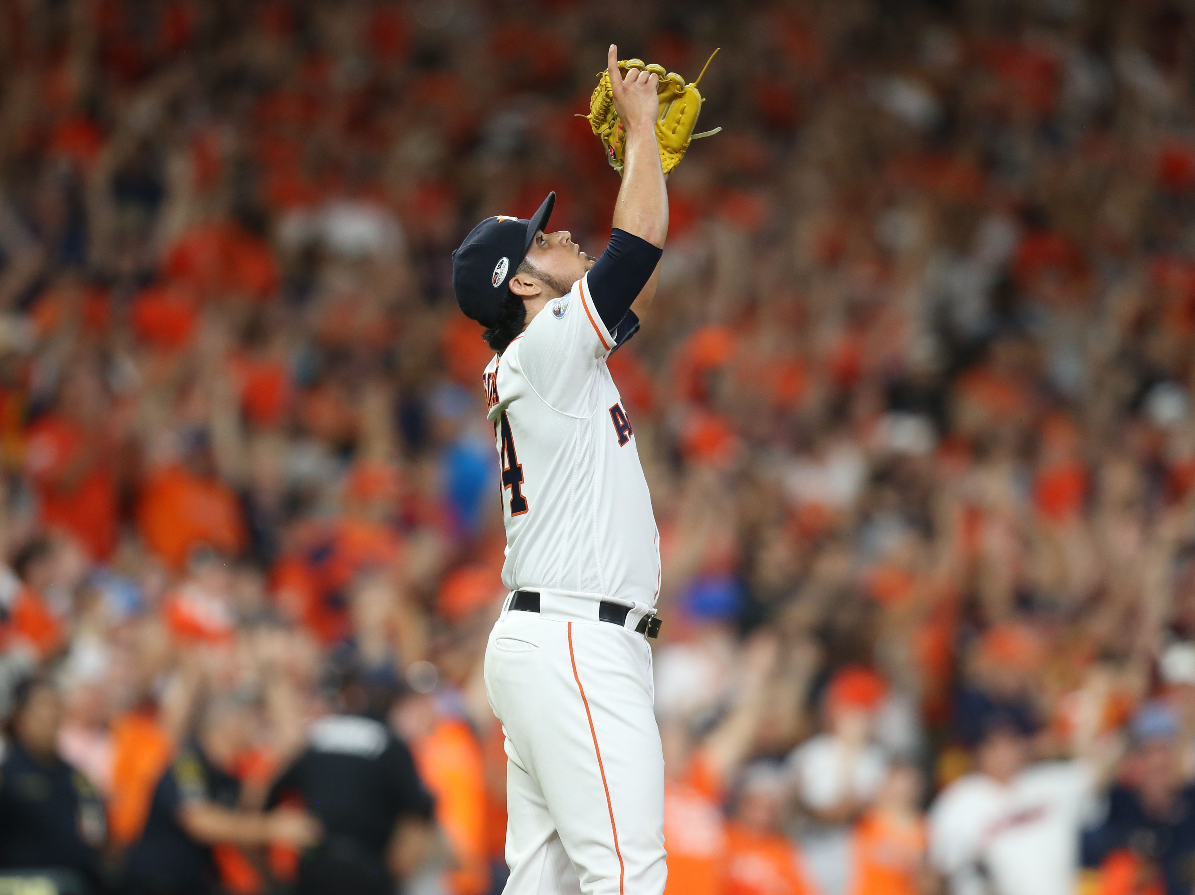 ALDS Game 2: Astros closer Roberto Osuna points to the sky after earning the save in Game 2.