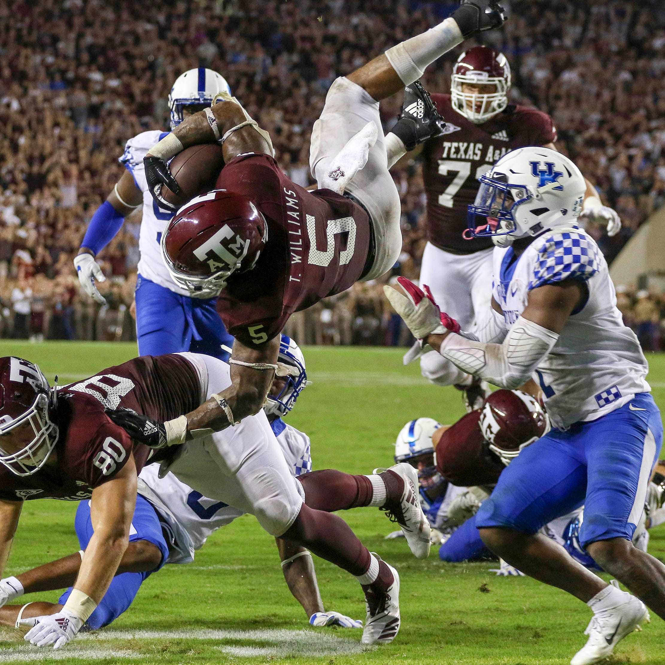 Texas A&M running back Trayveon Williams crosses the goal for a game-winning touchdown in overtime against Kentucky.