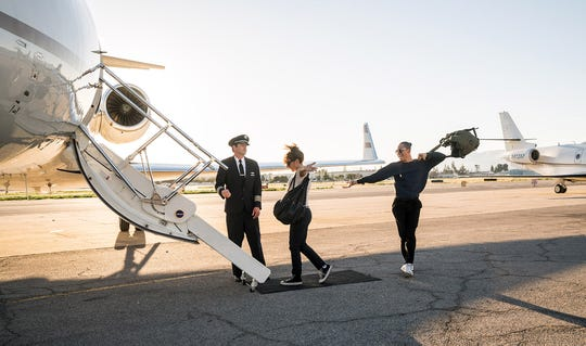"Ally (Lady Gaga) and Ramon (Anthony Ramos) get set to take flight in a private jet in ""A Star Is Born."""