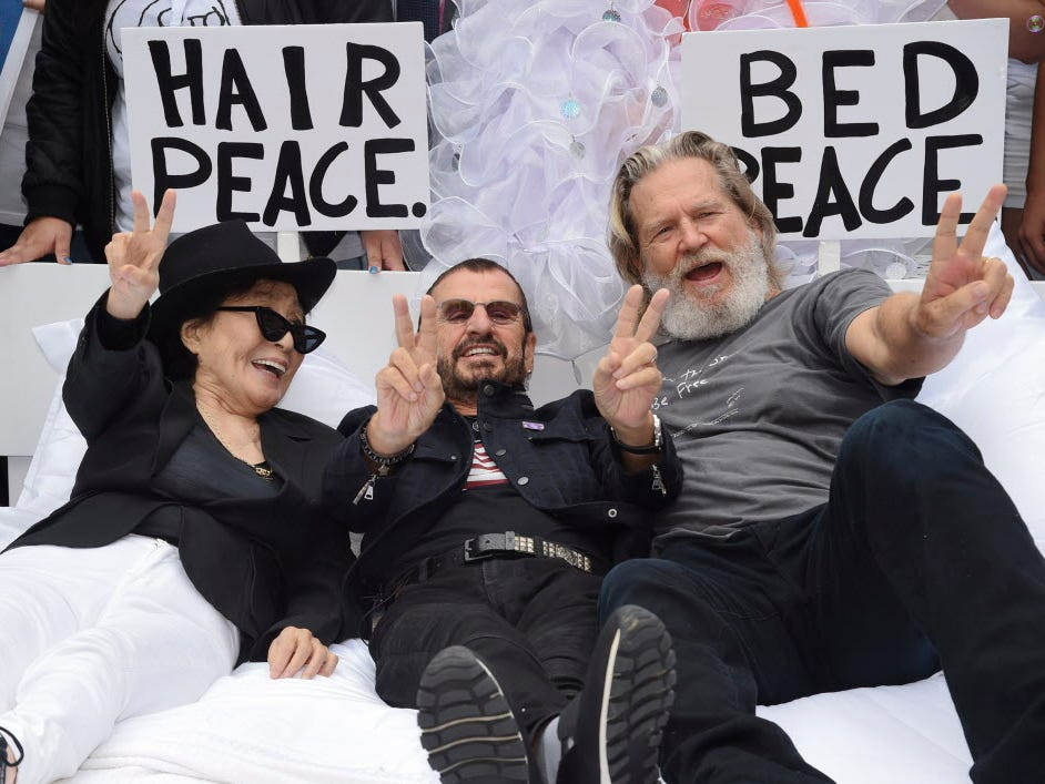 Yoko Ono, from left, Ringo Starr and actor Jeff Bridges participate in the fifth annual Come Together: NYC bed-in celebration to support New York City schools and to promote the return of the John Lennon Educational Tour Bus at City Hall on Thursday, Sept. 13, 2018, in New York. (Photo by Evan Agostini/Invision/AP) ORG XMIT: NYEA108