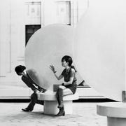 "John and Yoko sitting at one of five plinths of George Adamy's Plexiglas artwork ""Month of June, 1970"" on Sept. 4, 1971."