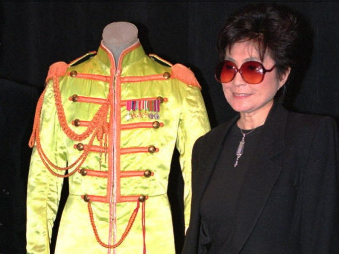 Yoko Ono with the costume John Lennon wore in Sgt. Peppers at a press conference in NY Thursday where Ms. Ono donated some John Lennon memorabelia to the Rock and Roll Hall of Fame. Photo by Robert Deutsch, USAT ORG XMIT: ny3