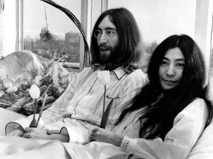 "ORG XMIT: APHS109 Jon Lennon and his wife Yoko Ono hold a ""bed in"" for peace in Amsterdam. AP photo [Via MerlinFTP Drop]"
