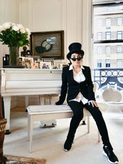 Yoko Ono at home in New York on her 85th birthday (Feb. 18, 2018), seated at the white Steinway grand piano given to her by John Lennon.