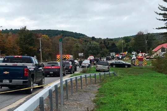 In this Saturday, Oct. 6, 2018 photo, emergency personnel respond to the scene of a deadly crash in Schoharie, N.Y.