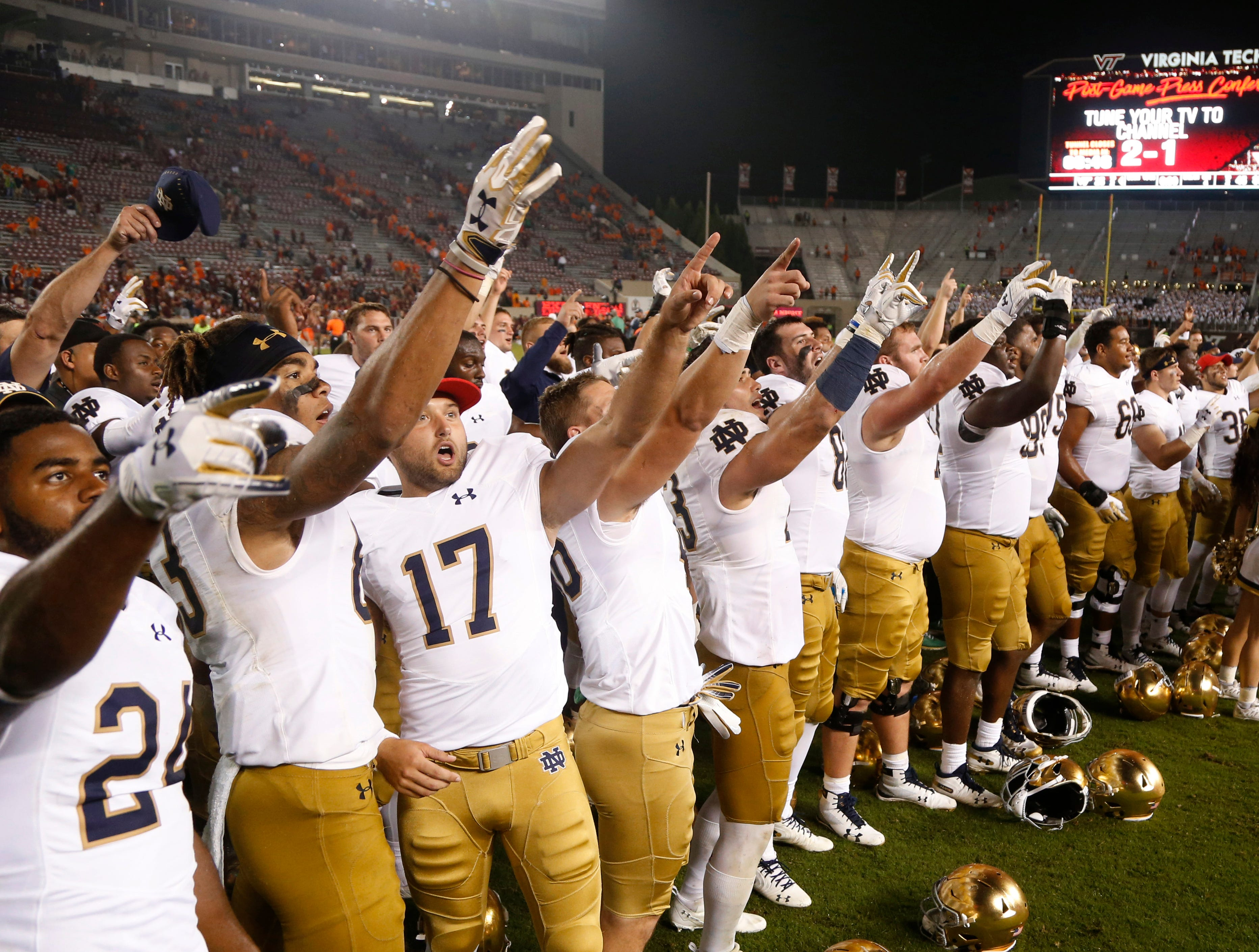 Notre Dame players celebrate a 45-23 win against Virginia Tech that improved their record to 6-0.