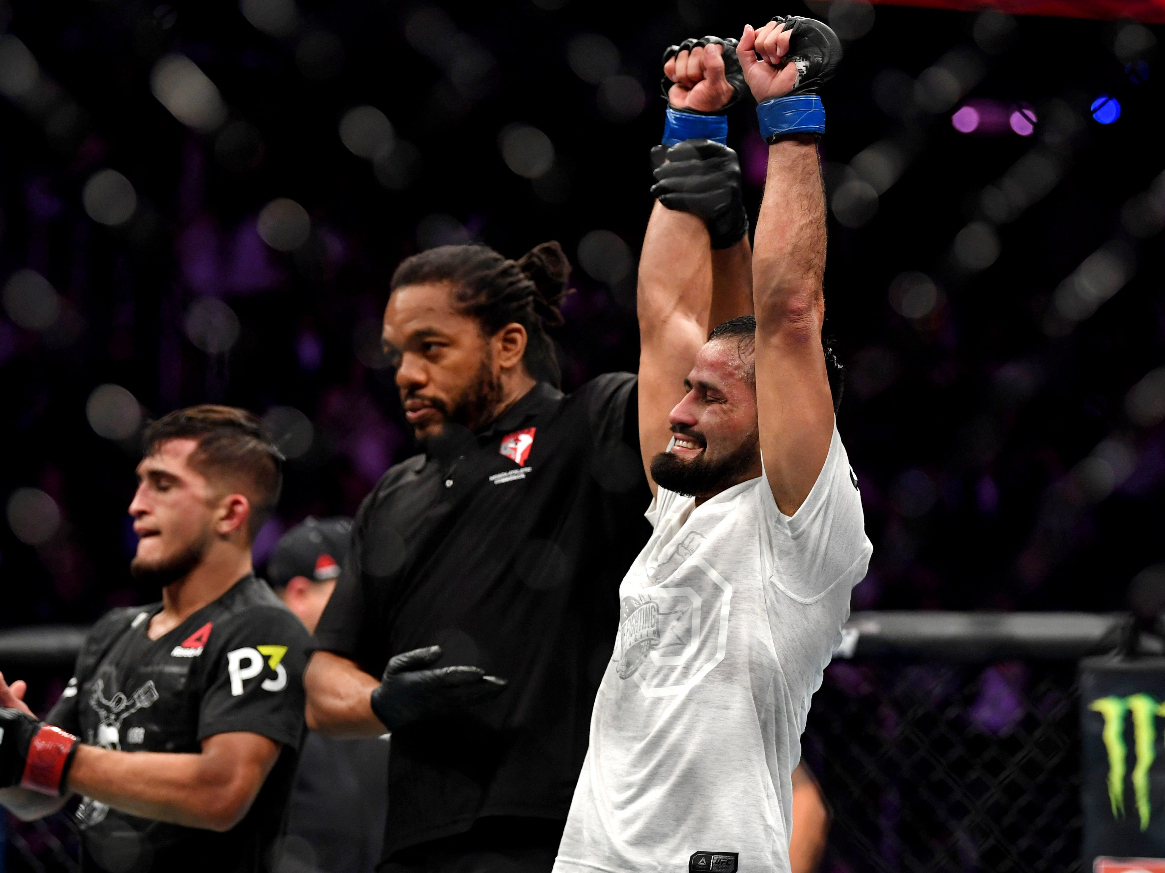 Jussier Formiga celebrates after winning a unanimous decision over Sergio Pettis.