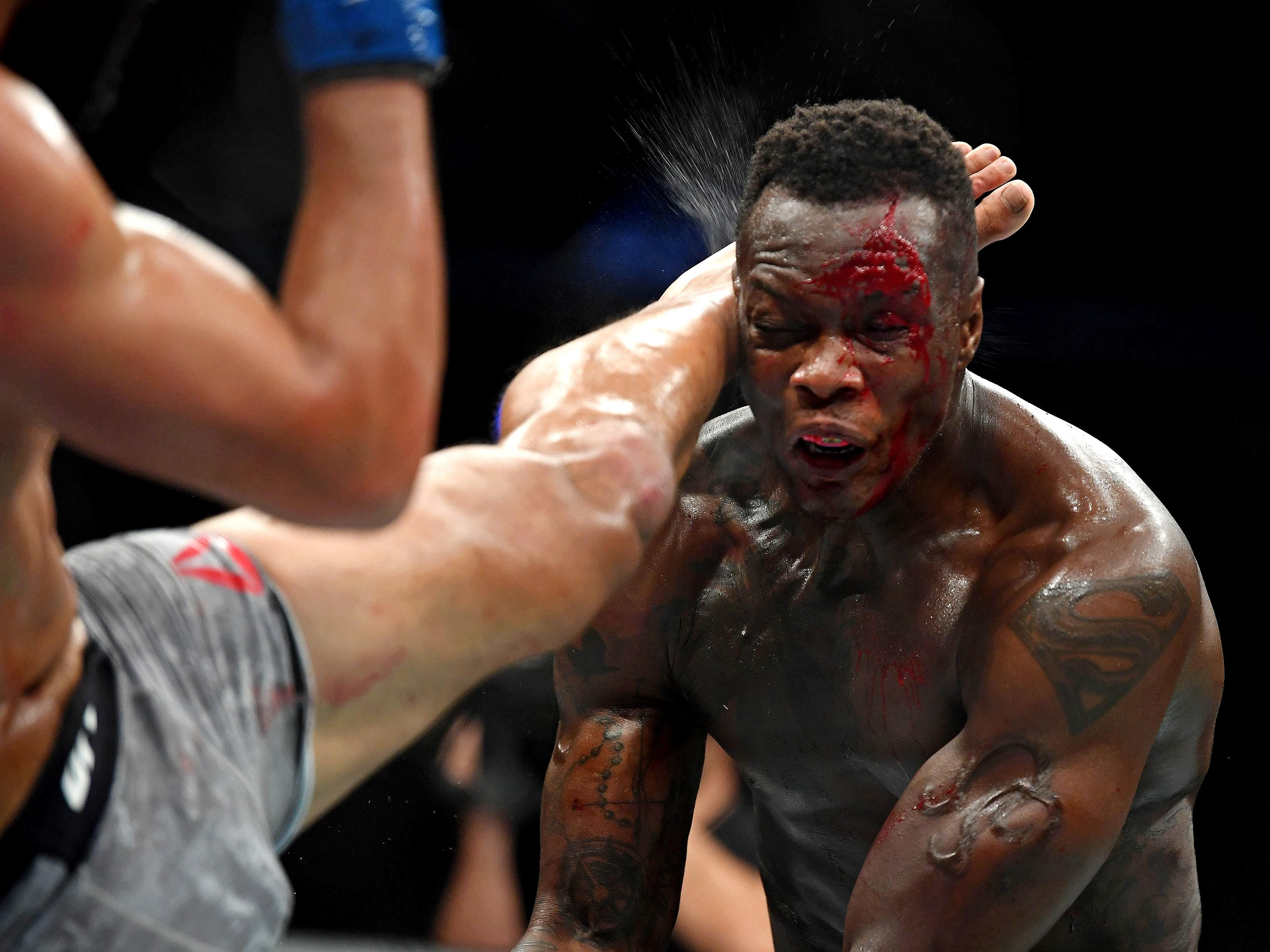 Ovince Saint Preux takes a kick to the head from Dominick Reyes during their light heavyweight fight.