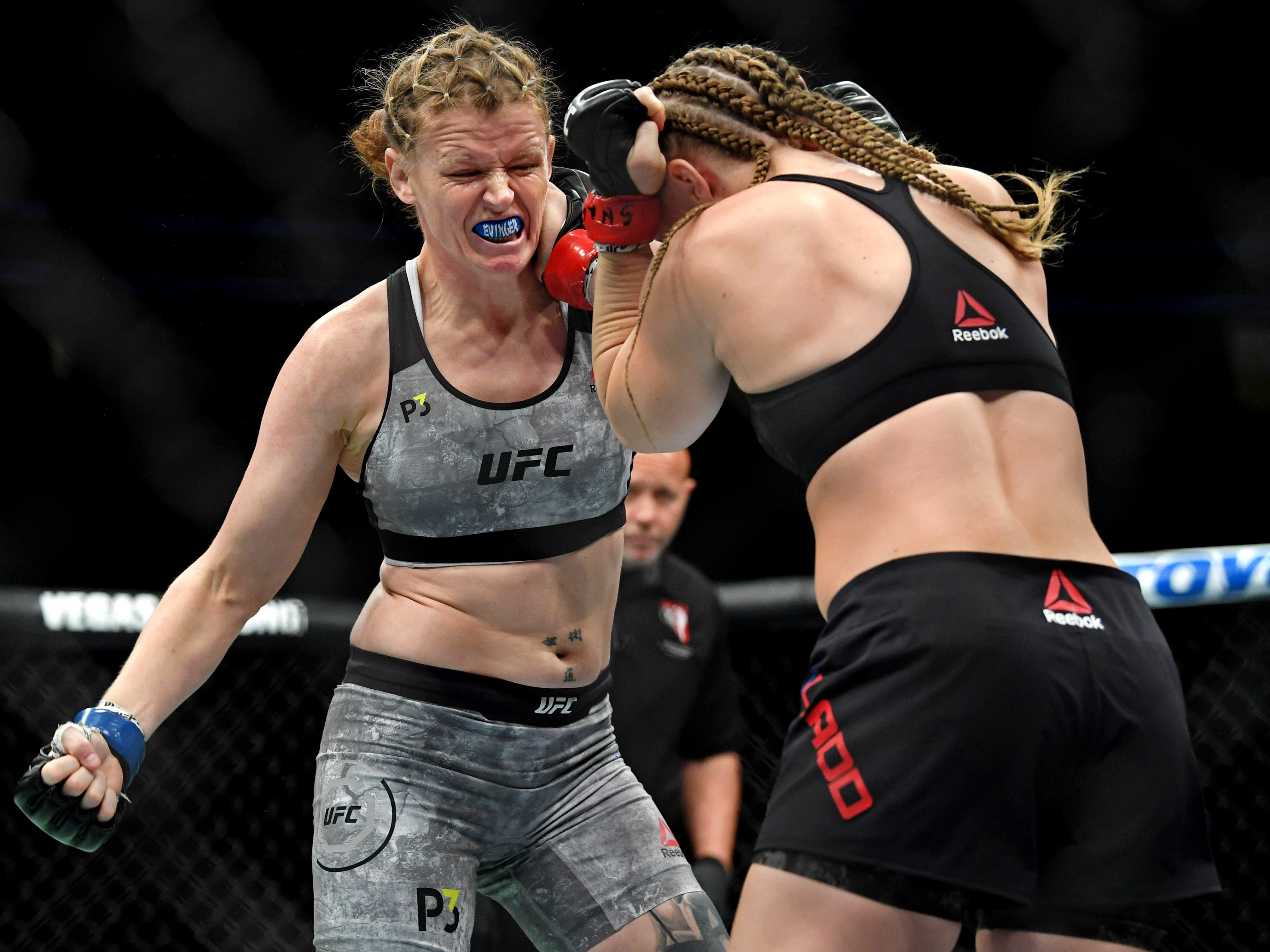 Tonya Evinger, left, winds up for a punch against Aspen Ladd.