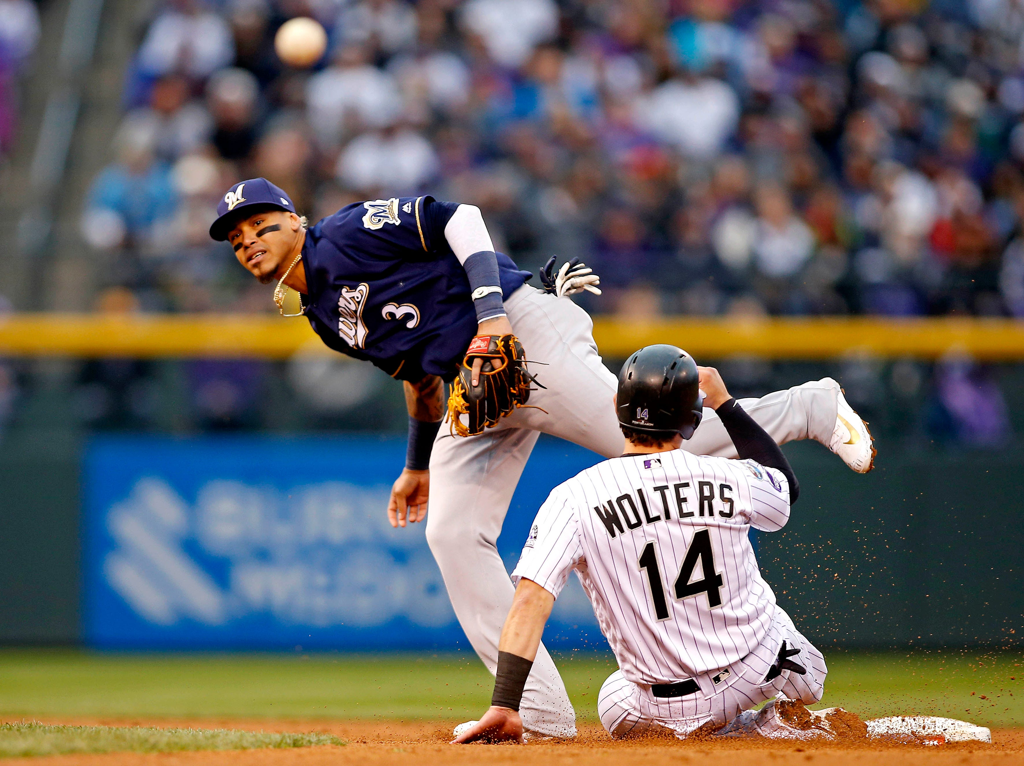 NLDS Game 3: Brewers shortstop Orlando Arcia forces out Rockies catcher Tony Wolters and throws to first in the fifth inning.