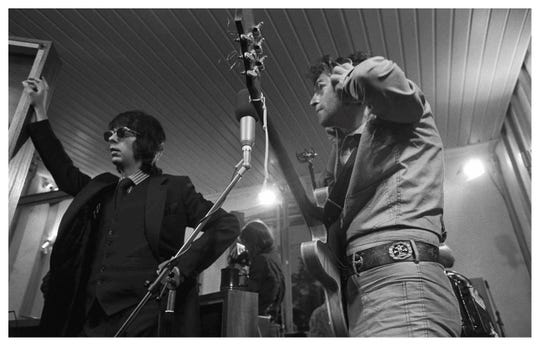 """John Lennon and Phil Spector rehearsing """"How Do You Sleep?"""" in the studio on May 26, 1971."""