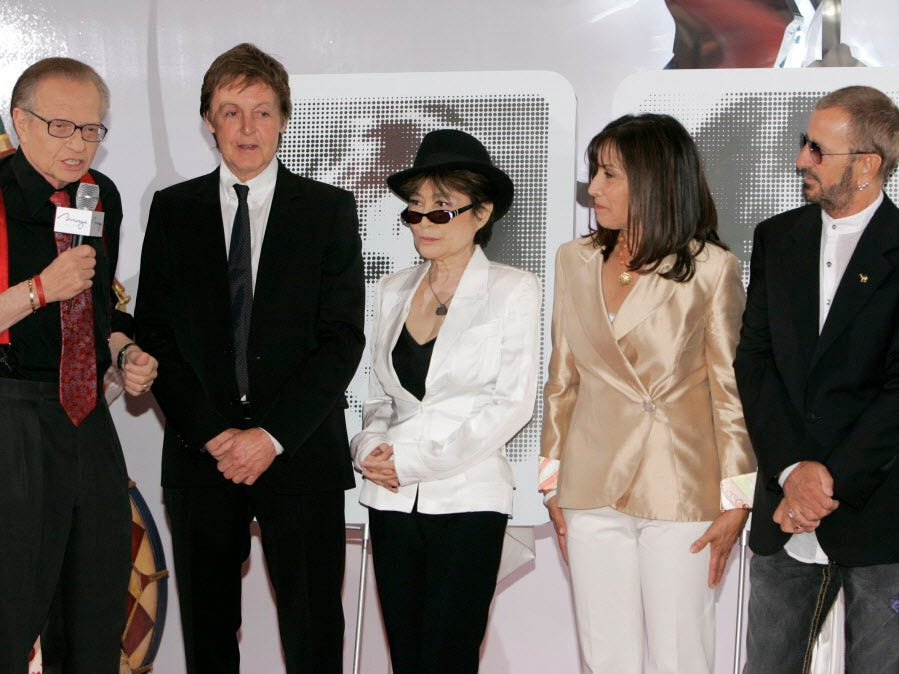 Talk show host Larry King, left, joins Paul McCartney, from second left, Yoko Ono Lennon, Olivia Harrison and Ringo Starr during the first anniversary of the Beatles Love at the Mirage hotel-casino in Las Vegas, Tuesday, June 26, 2007.  (AP Photo/Jae C. Hong) ORG XMIT: NVJH110