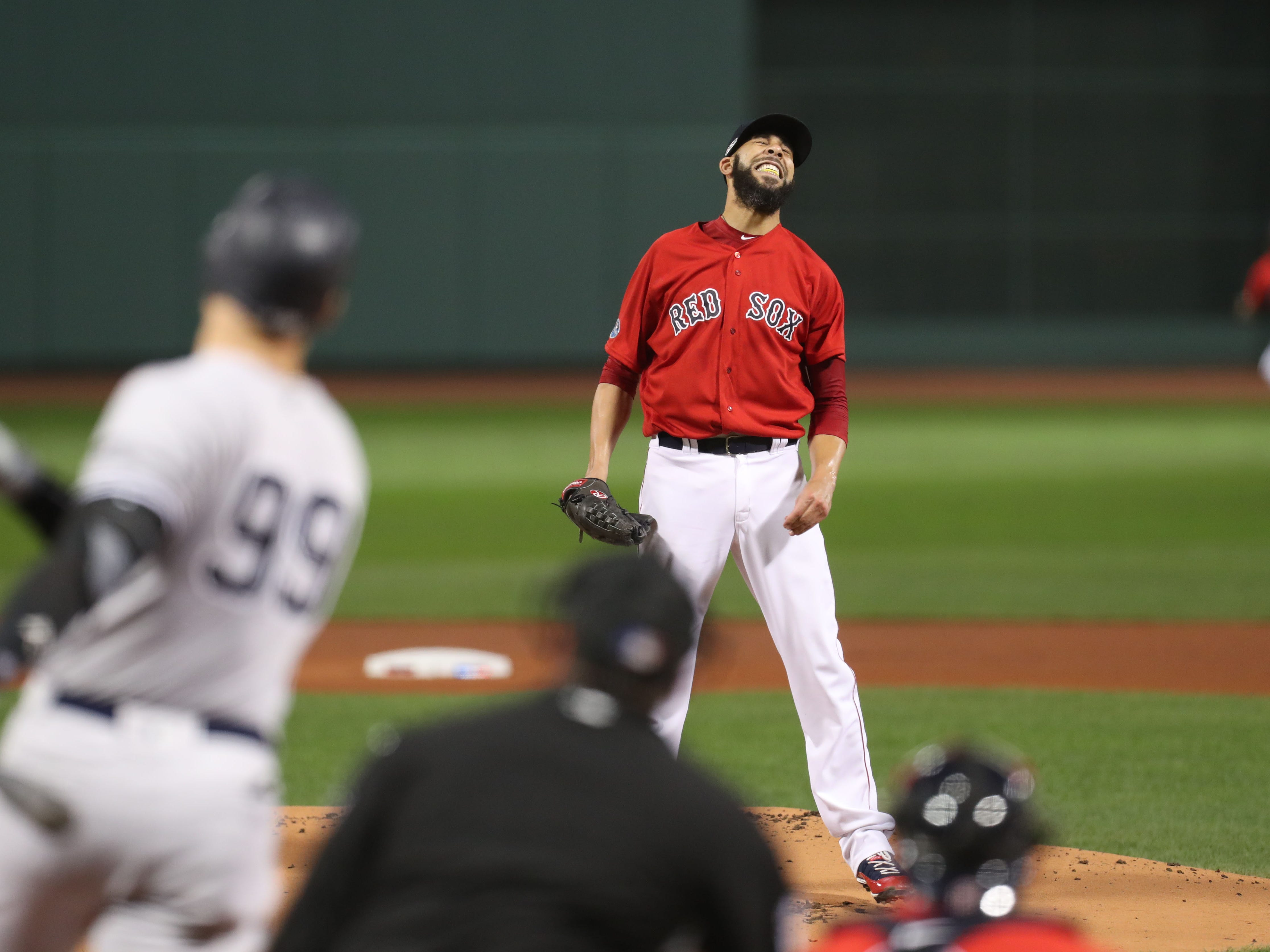 ALDS Game 2: Red Sox starting pitcher David Price reacts after Yankees right fielder Aaron Judge hits a solo home run in the first inning .