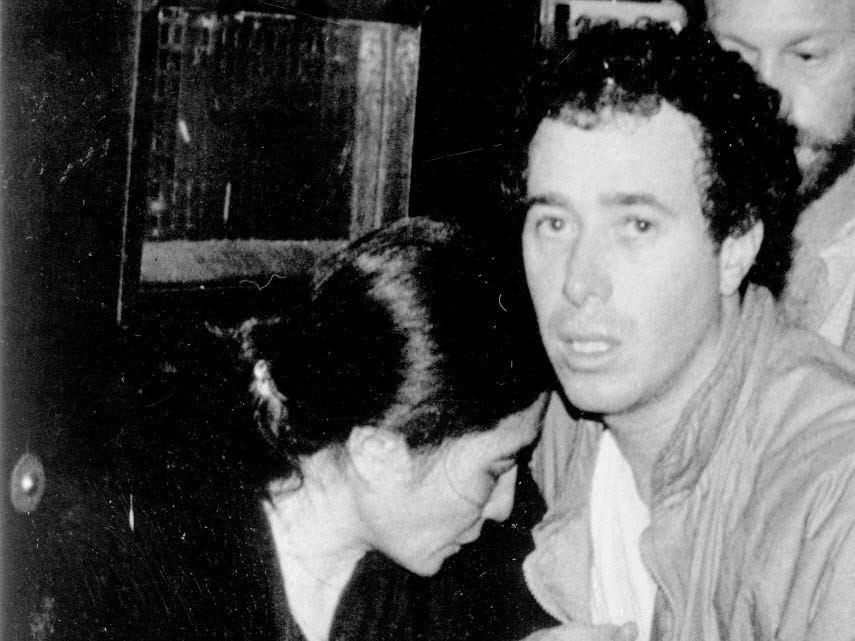 ORG XMIT: APHS313 Record producer David Geffen comforts Yoko Ono as they leave Roosevelt Hospital in New York, Dec. 9, 1980, after the shooting and death of Ono's husband John Lennon. Lennon was shot and killed Dec. 8 as he returned to his apartment after returning from the recording studio. (AP Photo/Lyndon Fox) [Via MerlinFTP Drop]