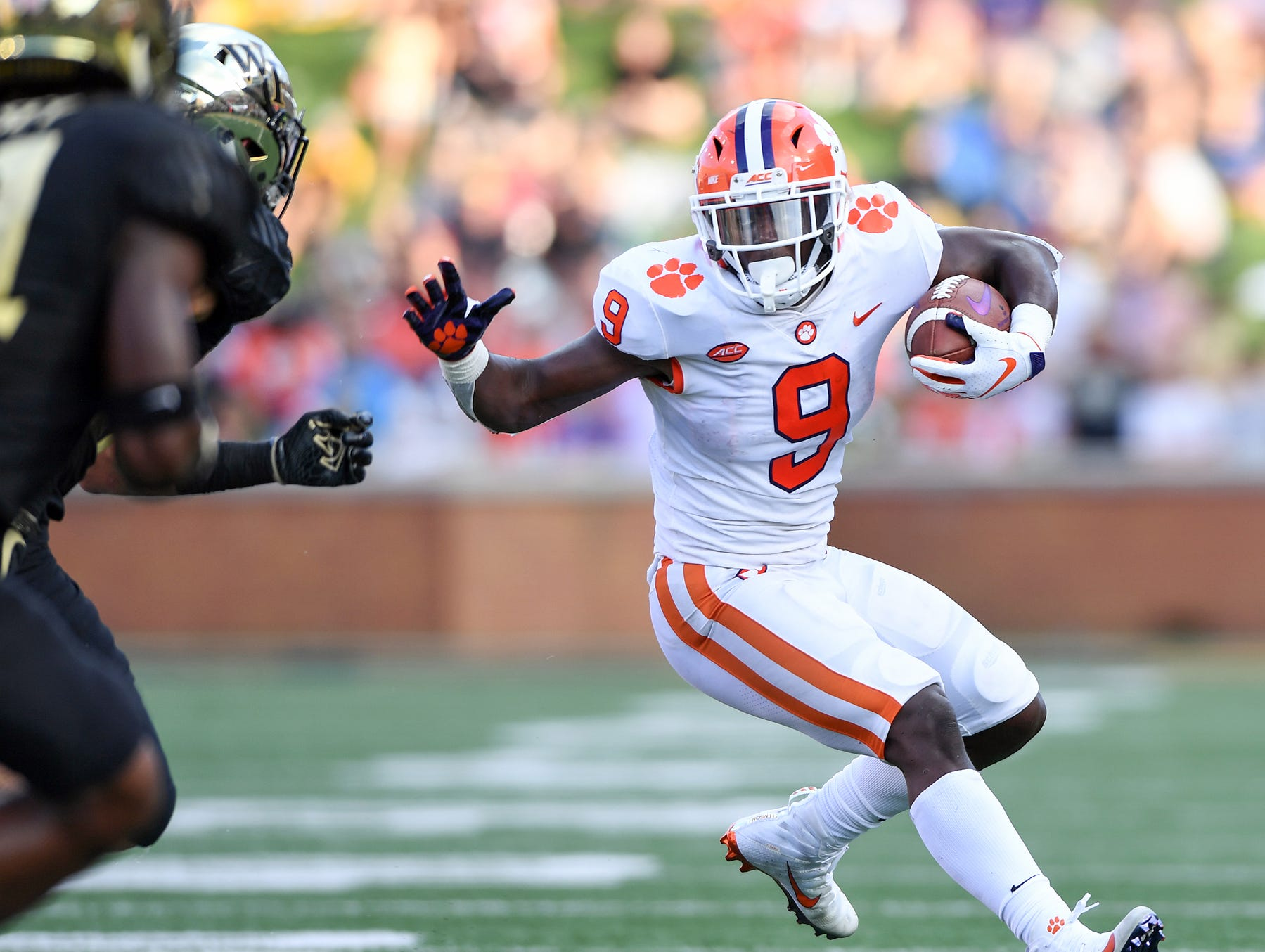 Clemson running back Travis Etienne (9) is moving into the Heisman Trophy picture with his play this season.