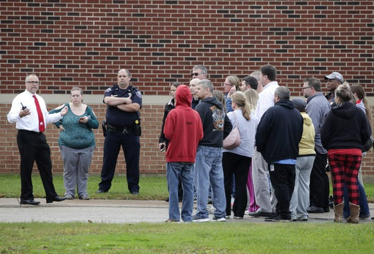 Robert Mayfield, superintendent of the Kimberly Area School District, speaks to concerned family members outside Mapleview Intermediate School after an intruder alarm was triggered Monday. It was a false alarm.