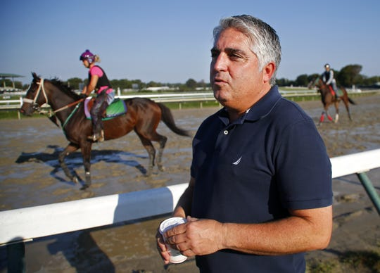 Monmouth Park trainer Gregg Sacco, observes morning workout at Monmouth Park Racetrack, Oceanport, N.J. Wednesday, October 3, 2018.