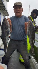 Tom Punentino with a pair of sea bass on the Dauntless party boat Oct. 8, 2018.