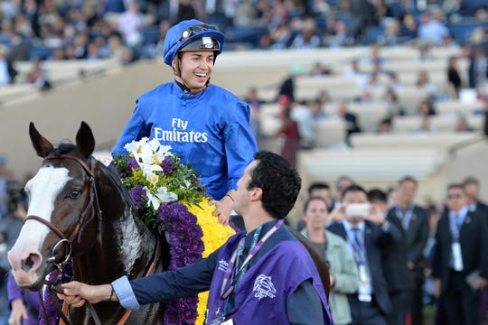 Nov 4, 2017; Del Mar, CA, USA; Talismanic jockey Mickael Barzalona smiles after winning the 11th race during the 34th Breeders Cup world championships at Del Mar Thoroughbred Club.