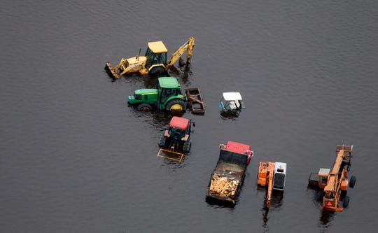 On Sept. 16, 2018, farm equipment is surrounded by floodwaters in the aftermath of Hurricane Florence near Trenton, NC.